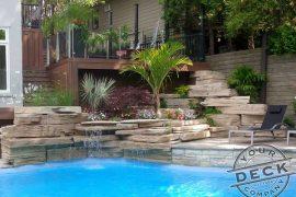 Deck builder in Oakville. Custom Trex low maintenance deck overlooking a pool