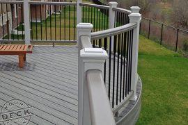 Deck builder in Stouffville. Trex Transcend curved railing.