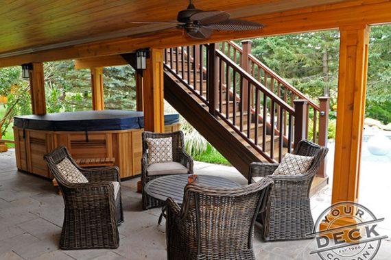 Waterproof deck with a cedar ceiling. Deck builder in Aurora
